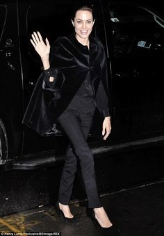 Her other half: Angelina - seen Tuesday at a screening of new film Unbroken - was without ...