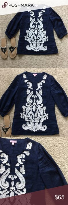 """Lilly Pulitzer Beaded Tunic Lilly Pulitzer Beaded Linen Tunic. Gorgeous Navy blue with white appliqués and beading on the front and around the back of the neck. Looks great with white skinnies or ankle/Capri pants. 3/4 sleeves. V neck. Laying flat approx 26"""" shoulder to hem, approx 18.5"""" pit to pit. 100% linen, 100% cotton lining. Size XS. Excellent condition aside from one appliqué in the back is missing the beads. I didn't notice until I was listing. I don't think it would be noticed…"""