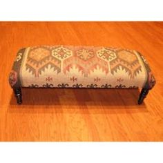 @Overstock.com - With a distinctive style, a gorgeous upholstered ottoman from India will add splendor to any decor. This ottoman is hand-made with a geometric pattern in shades of ivory, rust, black, soft orange, light green.http://www.overstock.com/Worldstock-Fair-Trade/Handmade-Kilim-Upholstered-Bench-India/6805529/product.html?CID=214117 $215.99