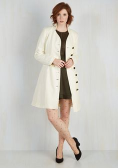 Outdoor Orchestra Coat in Ivory. Few things brighten up a brisk day quite like stumbling upon a spontaneous performance in the park in this timeless off-white coat! #white #modcloth