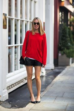 Fiona in a red jumper, a black leather skirt and black stilettos.