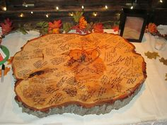 Slab of wood as a guest book!  big enough for a note not just signatures