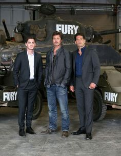 Bovington, England - August 28, 2014: (L-R) Logan Lerman, Brad Pitt and Jon Bernthal pose in front of a Sherman Tank during FURY Photo Call at The Tank Museum. - See more at: http://www.411celeb.com/movies/fury/photos/4#sthash.I6TiRZjX.dpuf