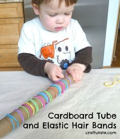 Cardboard Tube and Elastic Hair Bands - fine motor skills practice Motor Skills Activities, Toddler Learning Activities, Montessori Toddler, Toddler Play, Gross Motor Skills, Montessori Activities, Infant Activities, Toddler Crafts, 2 Year Old Activities