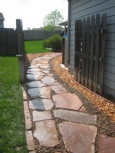 Flagstone pathway with Colorado Red Flagstone and Colorado Red Edging stone by Land Escapes Inc.