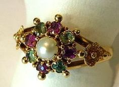 This rare Suffragette Ring features Green Beryls, a White Pearl and Violet Rhodolite Garnets in 15ct Gold. (Only $995!)
