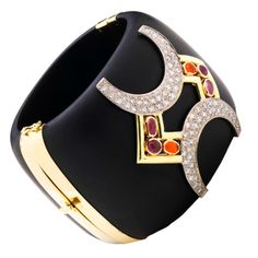 """hello lover!  Horseshoe Jet Cuff  USA  21st Century  KARA ROSS - This hand carved Jet Cuff showcases multi-colored gemstone cabochons which accent two 18k gold and pave brilliant cut round diamond """"Horseshoes"""". The gemstones used are, Pink Tourmaline, Amethyst, and Fire Opal."""