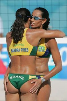 Olympic Beach Volleyball Players have magic butts that make them jump high but they appear to be magnetic, careful if you get close! This is Sandra Pires of Brasil and her magic magnetic butt