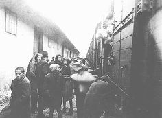 Macedonian Jews prepare to board a deportation train in Skopje. Skopje, Yugoslavia, March 1943.