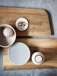 Tilt Cutting Board, Oak Design by Tobias Tøstesen Bottle Grinder, New Norm Bowl, New Norm plate/lid Design by Norm Architects