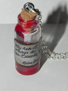 Anita Blake My Heart Belongs to Jean Claude Bottle Necklace. $15.21, via Etsy.
