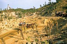 The Frontierland stagecoach passing below the Mine Train through Nature's Wonderland.