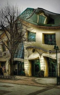 The Crooked House In Sopot, Poland. The Crooked House was built in 2004 and inspired by the paintings and drawings of Jan Marcin Szancer, a Polish artist and illustrator of children's books, and Per Dahlberg, a Swedish painter. There is absolutely no other building like this one!
