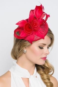 This vintage-inspired fascinator is as timeless as a fairytale. Let your personality add life to its floral center and ribbon loop accents. It's round base ...