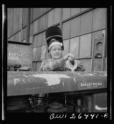 Bethlehem-Fairfield shipyards, Baltimore, Maryland. 'Girl' #welder resting on a welding machine. From a Library of Congress collection.