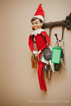 Found Harry,The Elf on the Shelf, hanging with the keys. Hmm... wonder if he went for a joy ride?