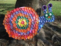 This looks like recycled plastic lids made into outdoor artwork.