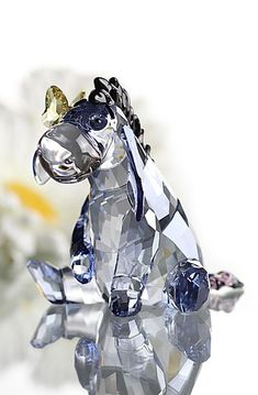 With big Jet crystal eyes, lovable Eeyore shines in Light Sapphire Silver Shade crystal with a Dark Indigo mane and tail tip. A delicate Jonquil cr...