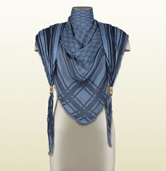 Gucci: light blue and blue shawl with branded metal detail
