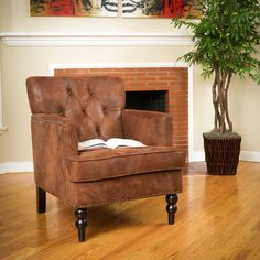 The Malone club chair features studs, tufting, and even carved wood legs that denote only the finest club chair elegance.
