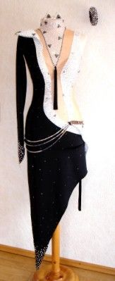 "Elegant black and white latin dress with moderate stoning, rhinestone belt, and a tassle ""necklace."" Visit http://ballroomguide.com/comp/attire/lady.html for more info about competition attire."