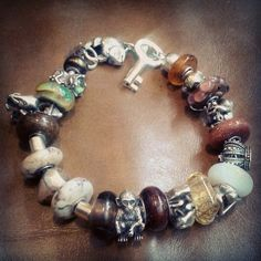 Wearing my #redbalifrog bracelet pulling together beads from lots of brands #trollbead #pandora and some non branded artisan beads, I love the natural combinations of #gold and #silver mixed with #autumn browns, greens and amber tones! Makes me want to curl up next a crackling fire with a hot coffee ♥ #trollbeads #trollbeadsusa #trollbeadsuk #trollbeadsfan #everystoryhasabead #nature #leather #amber