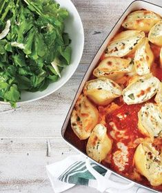 Spinach and Ricotta-Stuffed Shells! Ingredients 20  jumbo pasta shells (about half a 12-ounce box) 1  24-ounce jar marinara sauce 2  15-ounce containers ricotta 2  cups  baby spinach, chopped 1/2  cup  grated Parmesan (2 ounces) kosher salt and black pepper 1/2  cup  grated mozzarella (4 ounces) green salad (optional)