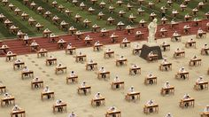 Hundreds of students of the school of nursing take part in an open-air examination at a playground of an vocational college in Baoji, Shaanxi province, China, May 25, 2015.  REUTERS/Stringer CHINA OUT. NO COMMERCIAL OR EDITORIAL SALES IN CHINA       TPX IMAGES OF THE DAY      - RTX1EEL1