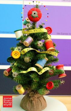 Adorable!  I think I may have to do this to my mini tree :)  Sewing-Themed Mini Christmas Tree :: Hometalk