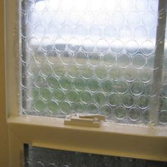 """Bubble wrap """"stained glass windows"""" - works well as window insulation too"""