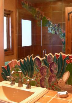 Southwest Desert Garden Bathroom Backsplash and shower inset tile mosaic. Hand cut and shaped tiles of saguaros, agaves, purple prickley pear and other desert cacti make this bathroom backsplash unique to Arizona Southwest Decor. Bright primary glazes add a brilliance of fun color to the decor.