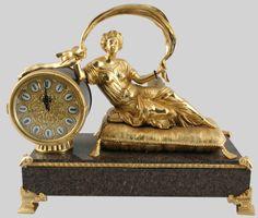 Bronze and marble clock / Reloj de bronce y porcelana