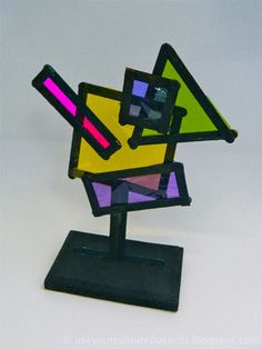 Black Popsicle Stick And Cellophane Sculpture. Color.