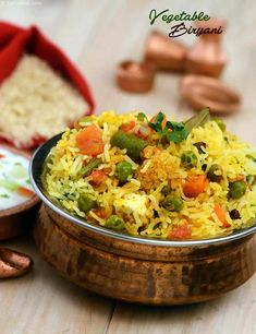 Vegetable biryani is the most popular and the most common rice dish that comes to one's mind when you think of indian cuisine. It is very tasty and definately worth a try ! Vegetarian Biryani, Vegetable Biryani Recipe, Vegetarian Recipes, Veg Biryani Recipe In Hindi, Rice Recipes, Indian Food Recipes, Cooking Recipes, Ethnic Recipes, Indian Foods