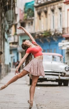 Dancers against city backdrops by Omar Robles (Cuba)