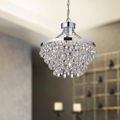 Add divine elegance to your home with this luxurious Ivana crystal chandelier with a chrome finish. With a base made of durable iron, this circular chandelier will make a great addition to your home.
