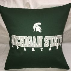 A personal favorite from my Etsy shop https://www.etsy.com/listing/478373963/state-of-michigan-university-pillow