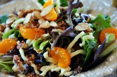 SPINACH SALAD -A bed of crisp greens, a layer of shredded mozzarella or Swiss Cheese, tiny bits of red onion,  crisp bacon, caramelized almonds, mandarin oranges and topped with a delicious Poppy Seed dressing.