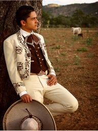 Cream/ ivory charro suit, but not brown... maybe one of the colors of all the color variation that I'm doing.     He looks cute ! Charro guys are my guys
