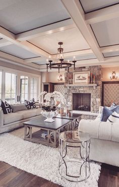 "What gorgeous room! Lots of Windows! Coffered Ceiling! That Fireplace! (*I'm confused as to why the walls are tufted/upholstered in either side of the fireplace. In all the years I've been a designer, I've not seen this treatment application in this location. It's a bit too ""boudoir"" for the family room. There are a few other ""outside of the box"" things that would look better/be more appropriate. Personal Opinion. GL