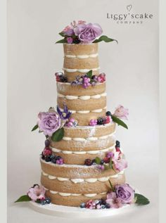 October Naked Victoria | Wedding Cake. Scalloped edge buttercream design with fresh flowers and fruit decoration.