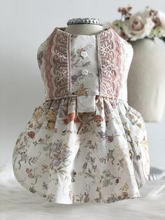 The perfect dog dress for your sweet furbaby. Woodland creatures, lace, and sweet pink flower button. What more can a girl want? This baby doll dog dress is perfect for your sweet fur baby! Print placement will vary from dress to dress. D-ring available upon request with an