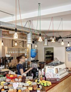 Coworking cafés Timberyard's grand hommage to the #LondonUnderground with vibrant Plumen 001 chandeliers. Available to buy at plumen.com.