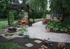 This project was designed to give this backyard an outdoor retreat that was secluded from the busy road to the back of the property. The babbling rock helps to mask this sound and gives you a soothing relaxed area to enjoy. The pergola has a fan to keep you cool in those hot summer afternoons!  Landscaping ideas, patios