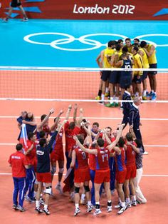 Members of team Russia, bottom, celebrate their victory over Brazil during a men's gold medal volleyball match at the 2012 Summer Olympics, Sunday, Aug. 12, 2012, in London. (AP Photo/Jeff Roberson)