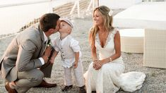 I had to share a favourite photo of mine from my good friend's wedding in Santorini, Greece!! At the time they had a two year old son Jack, who's a handsome lil devil- he's now 7! Wow time flies! :) I adore this candid moment of Jack giving his dad a kiss while Hannah looks on with happiness at her two boys.  What a stunning place to visit and have your wedding there. The turquoise water contrasted with the stark white homes is just so beyond words.