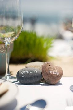alternative name cards - chalk names on little stones. Great for the beach wedding