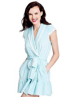 """Slip into this adorable terry cloth robe by Betsey Johnson. This robe features the word """"Wifey"""" across the back on the blue robe and 'The Bride' on the white robe in rhinestones! It is finished with short cap sleeves, pockets, a large bow on the back and ruffle trim detail. Perfect for your honeymoon or wedding day! Available in sizes Small-2X."""