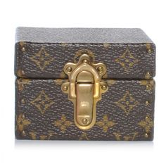 This is an authentic LOUIS VUITTON Monogram Ring Box Mini Trunk Case. This stylish case is crafted of classic Louis Vuitton monogram coated canvas.