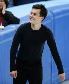 Chan of Canada smiles after a figure skating training session in preparation for the 2014 Sochi Winter Olympics